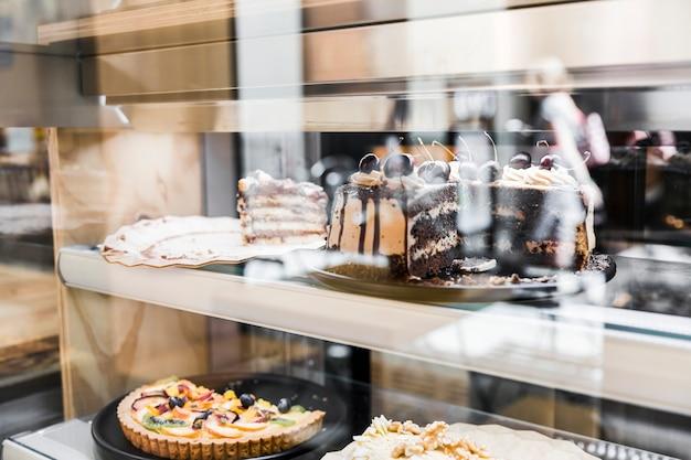 Various fresh cakes in window display Free Photo