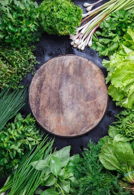 Various fresh herbs on a dark background Premium Photo