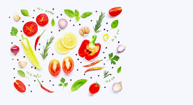 Various fresh vegetables and herbs on over white background. Premium Photo
