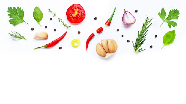 Various fresh vegetables and herbs on white. healthy eating concept Premium Photo