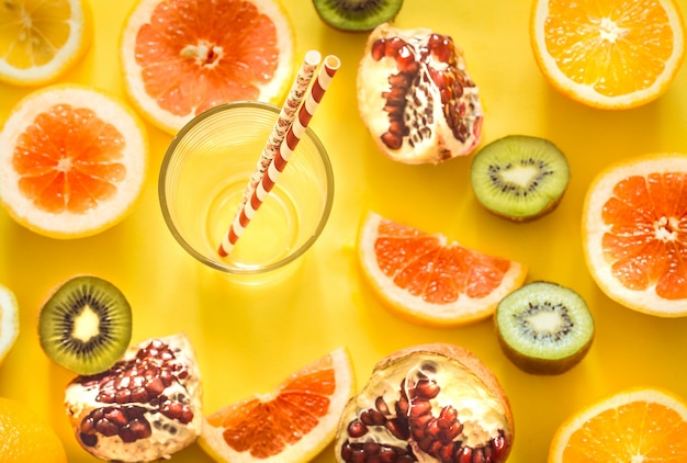 Various fruits and a glass with a straw Free Photo