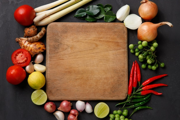 Various herbs, spices and ingredients on dark. top view Premium Photo