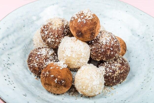 Various homemade raw vegan truffles or energy balls Premium Photo