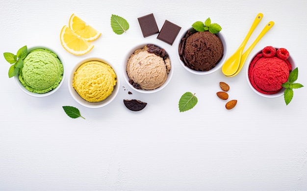 Various of ice cream flavor ball set up on white wooden background . Premium Photo
