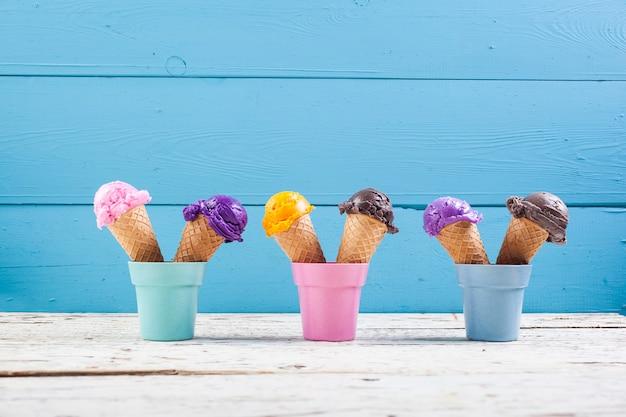 Various ice-cream scoops on blue Premium Photo