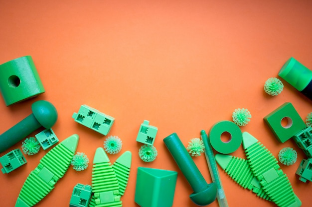 Various kids toys background in green colours, colorful assorted Premium Photo