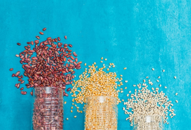 Various kinds of cereal grains in jars Free Photo