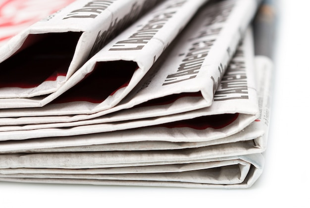 Various newspapers over white background Premium Photo