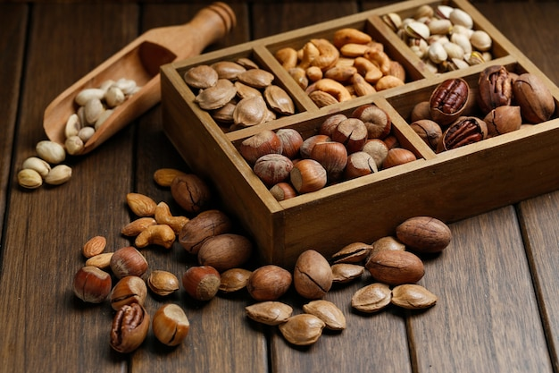 Various nuts in wooden box Free Photo