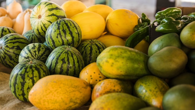 Various organic fruits for sale at supermarket Free Photo