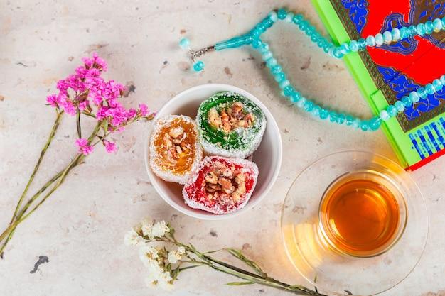 Various pieces of turkish delight lokum and black tea Premium Photo
