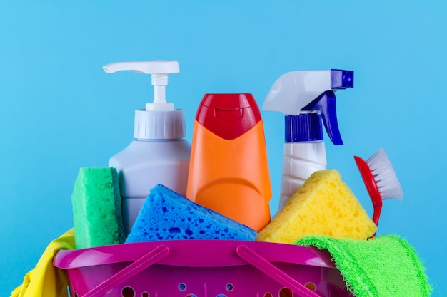 Various products for cleaning the house in a basket Premium Photo
