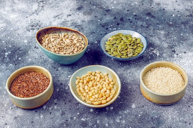 Various seeds - sesame, flax seed, sunflower seeds, pumpkin seeds for salads Free Photo