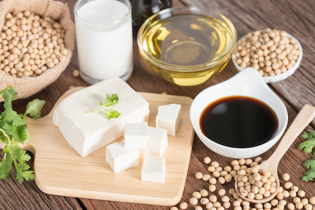Various soy products with soy sauce, tofu, oil, soy bean and soy milk. Premium Photo