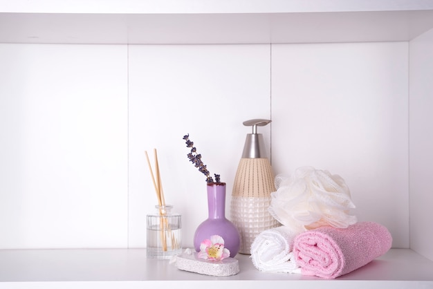 Various spa and beauty threatment products on white shelf Premium Photo
