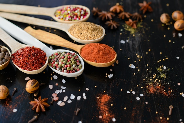 Various spices against a dark background. food ingredients. it can be used as a background Premium Photo