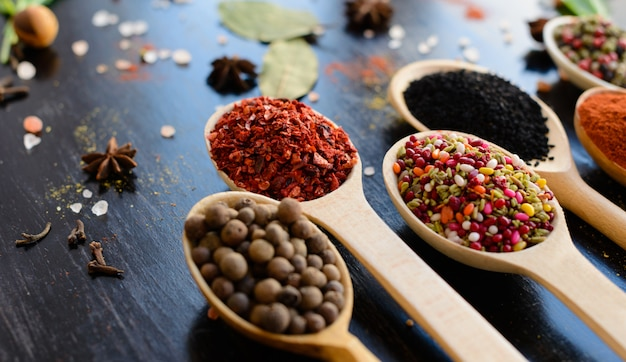 Various spices against a dark background. food ingredients Premium Photo