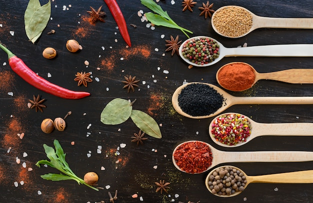 Various spices against a dark background. food ingredients Premium Photo