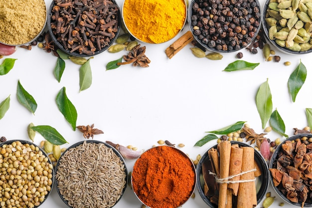 Various spices in a bowls on white. top view with copy space. Premium Photo
