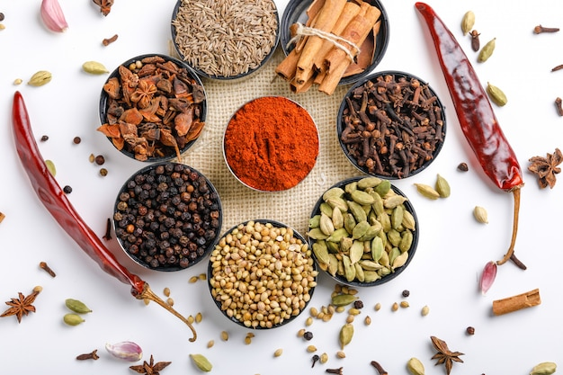 Various spices in a bowls on white Premium Photo