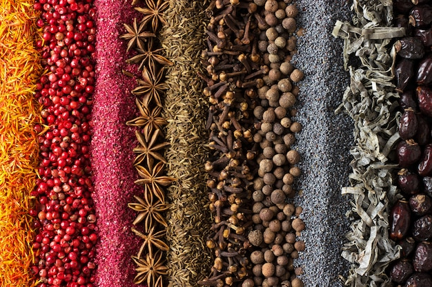 Various spices and herbs are scattered on table. seasoning backg Premium Photo