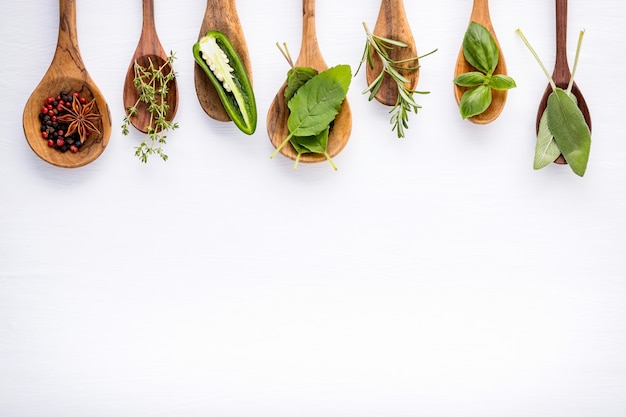 Various of spices and herbs on wooden background. Premium Photo