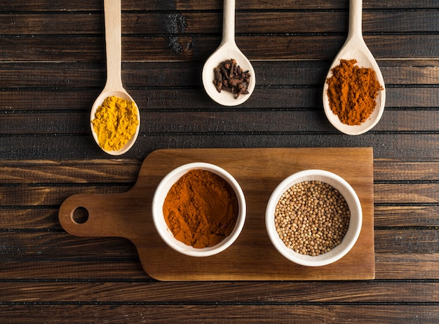 Various spices near cutting board Free Photo