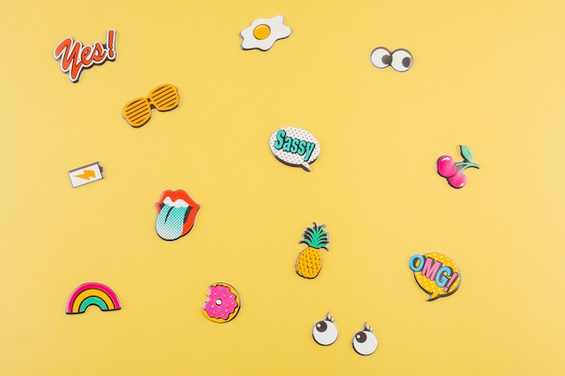 Various sticker on yellow background Free Photo