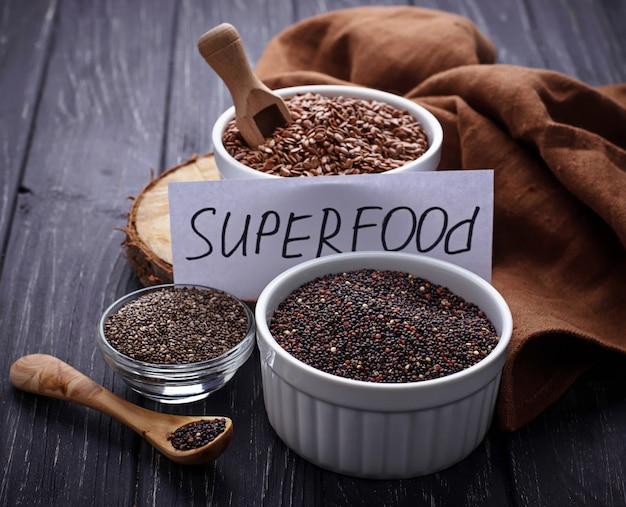 Various superfoods chia, quinoa, flax seed Premium Photo