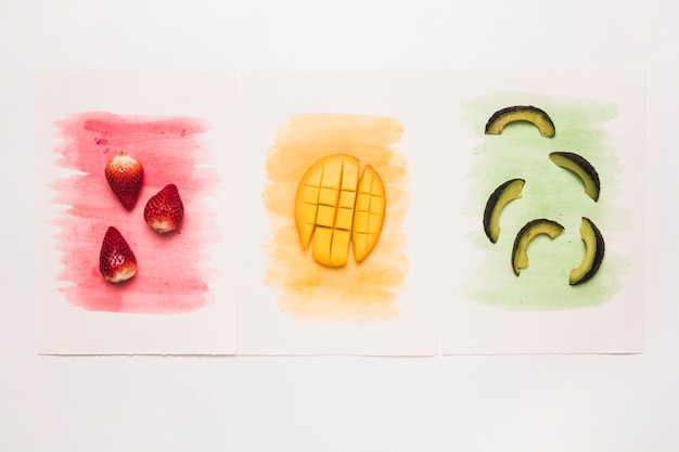 Various tasty fruits on multicolored watercolor splash Free Photo