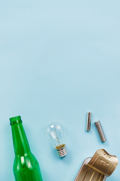 Various tips of recyclable garbage on light blue background Free Photo