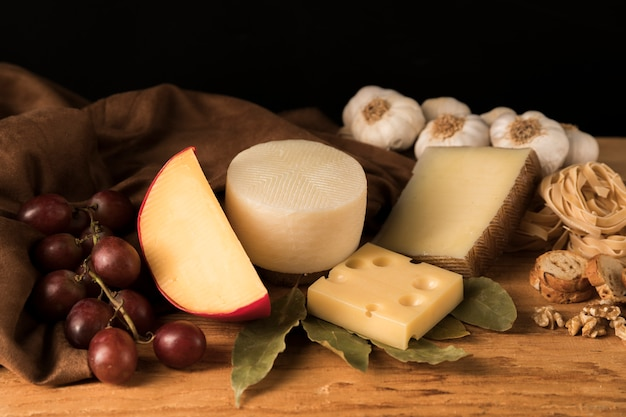 Various types of cheeses on kitchen counter Free Photo