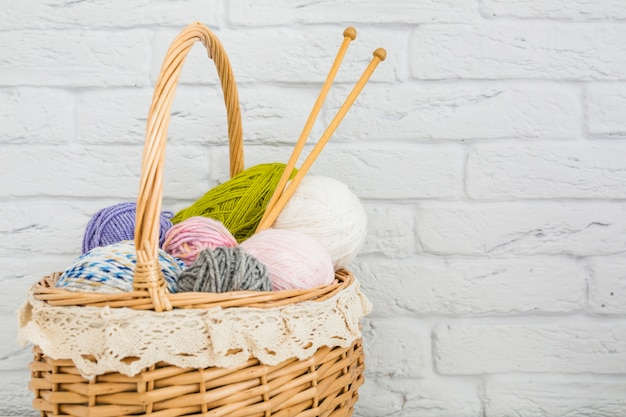Various types of colorful wools in wicker basket Free Photo