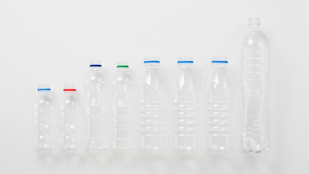 Various types of plastic bottles on grey background Free Photo