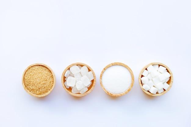 Various types of sugar on white background. Premium Photo