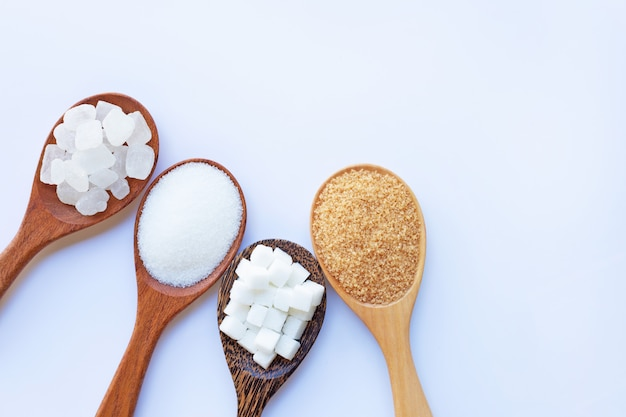 Various types of sugar on white. Premium Photo