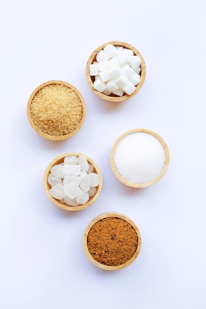 Various types of sugar on white. Premium Photo