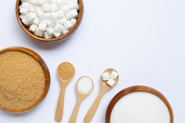 Various types of sugar on white Premium Photo