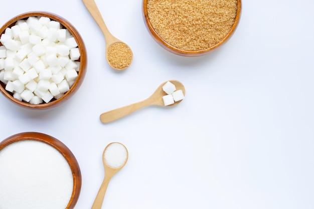 Various types of sugar on white . Premium Photo