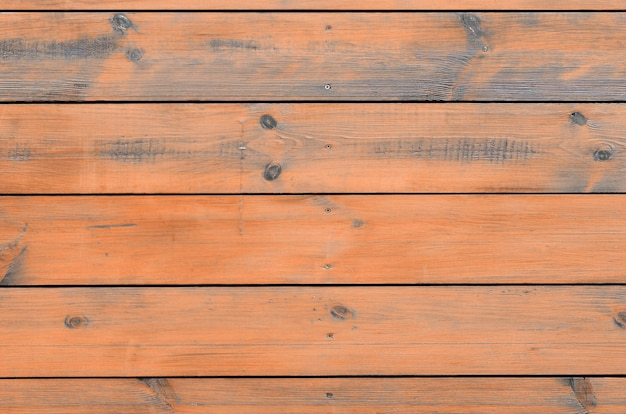 Varnished wood background from cabin exterior. brown wood barn plank Premium Photo