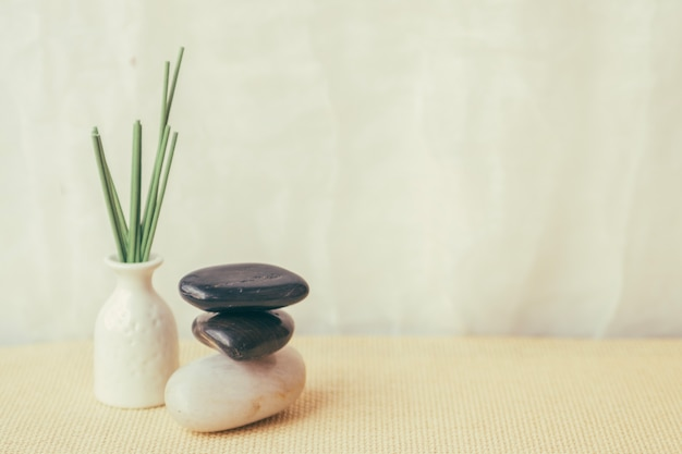 Vase and pile of pebbles Free Photo