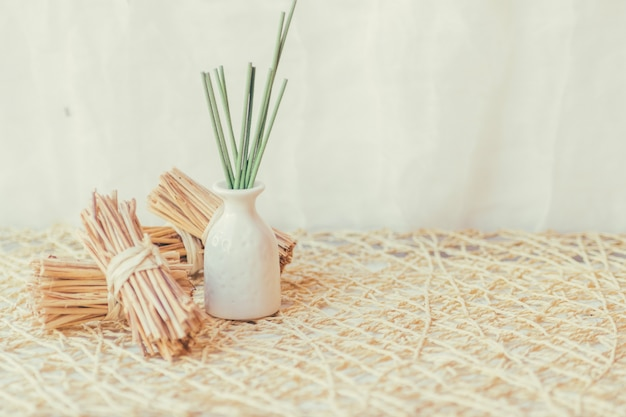 Vase with sticks near bunches of sticks Free Photo
