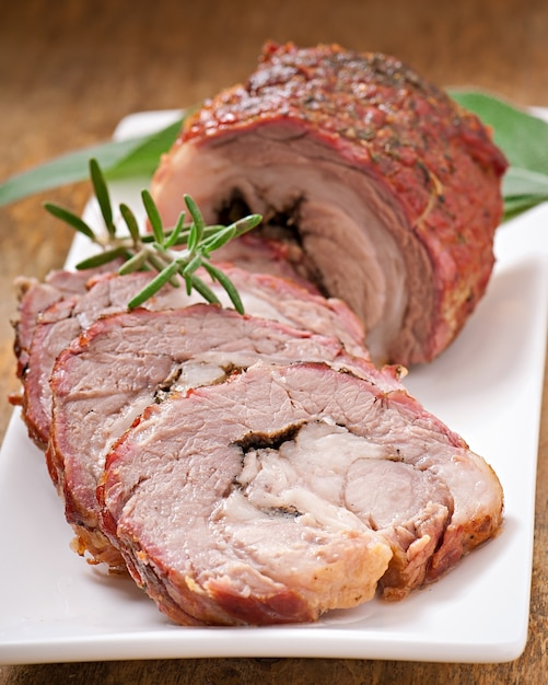 Veal roll filled with minced beef meat and herbs Premium Photo