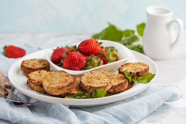 Vegan breakfast sweet tofu fritters (pancakes) with strawberries. healthy vegan food concept. Premium Photo