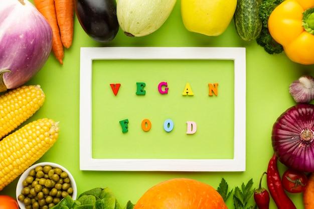 Vegan food lettering in white frame Free Photo