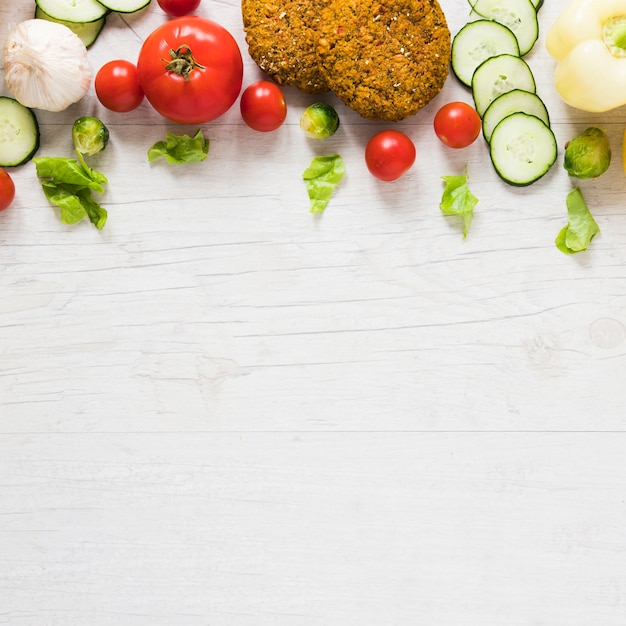 Vegan food on white background with copy space Free Photo