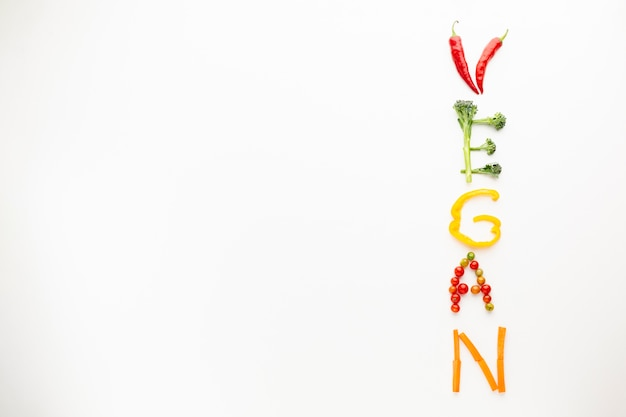 Vegan lettering made out of vegetables with copy space Free Photo