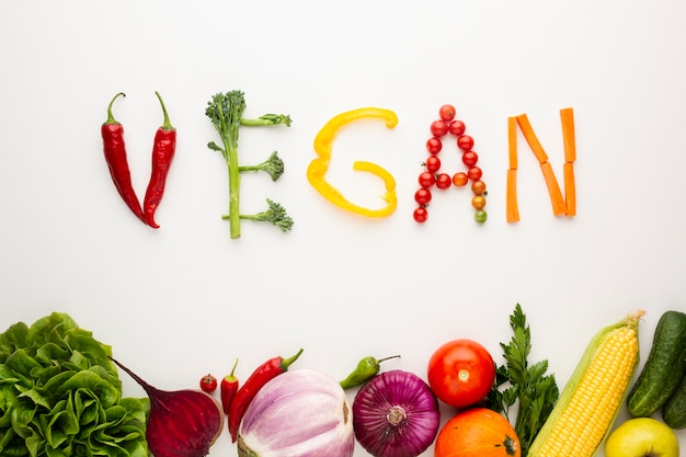 Vegan lettering made out of vegetables Free Photo