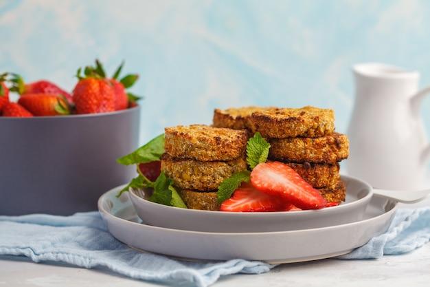 Vegan sweet tofu fritters (pancakes) with strawberries. healthy vegan food concept. Premium Photo