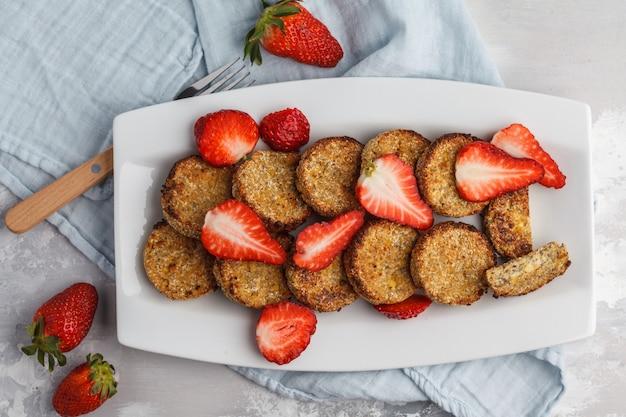 Vegan sweet tofu fritters with strawberries, top view. healthy vegan food concept. Premium Photo